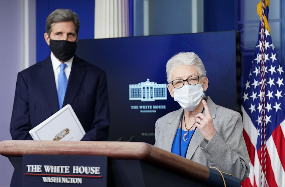 U.S. climate envoy John Kerry listens as climate adviser Gina McCarthy speaks during a press briefing at the White House in Washington, U.S., January 27, 2021.  REUTERS/Kevin Lamarque