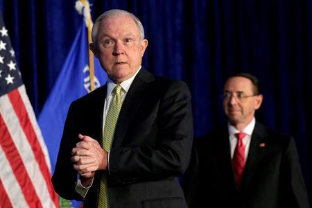 FILE PHOTO: Attorney General Jeff Sessions and Deputy Attorney General Rod Rosenstein arrive at a summit on crime reduction