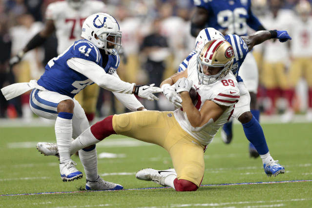 San Francisco 49ers tight end Cole Wick (89) is tackled by Indianapolis Colts defensive back Matthias Farley (41) and linebacker Zaire Franklin (97) in the first half of an NFL preseason football game in Indianapolis, Saturday, Aug. 25, 2018. (AP Photo/AJ Mast)