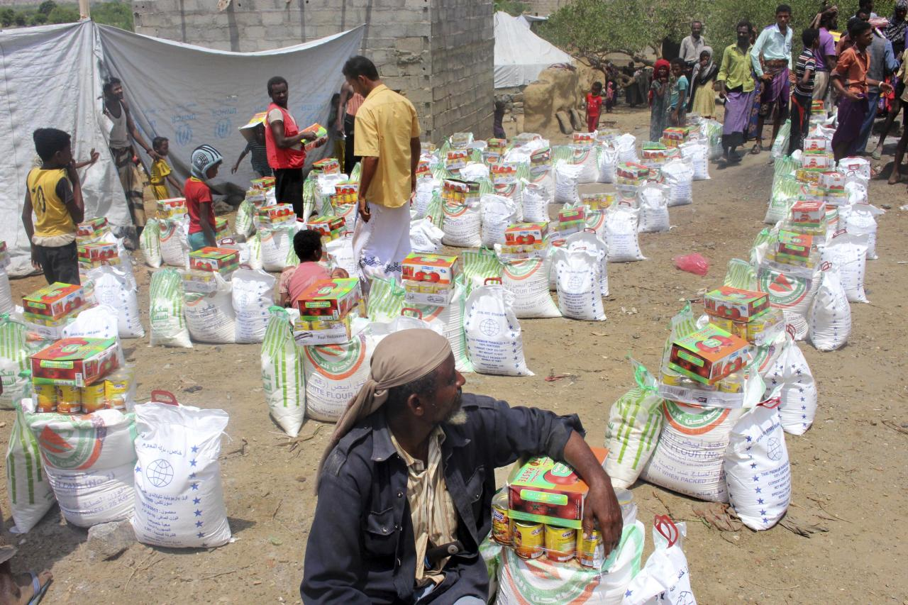 In this Sept. 23, 2018 photo, men deliver aid donations from donors, in Aslam, Hajjah, Yemen. The United Nations and independent donors are rushing food to this desperate corner of northern Yemen where starving villagers were found to be living off leaves. But the hunger crisis continues to worsen. (AP Photo/Hammadi Issa)