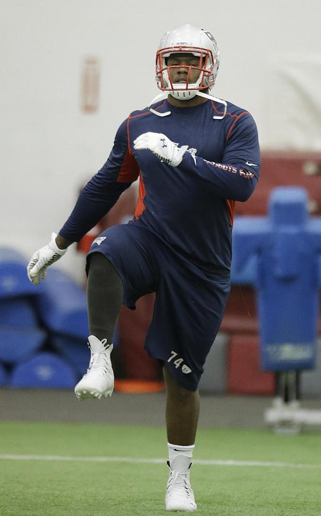 New England Patriots rookie defensive lineman Dominique Easley (74) runs during a stretching session at NFL football minicamp at the team's indoor training facility Tuesday, June 19, 2014 in Foxborough, Mass. (AP Photo Stephan Savoia)