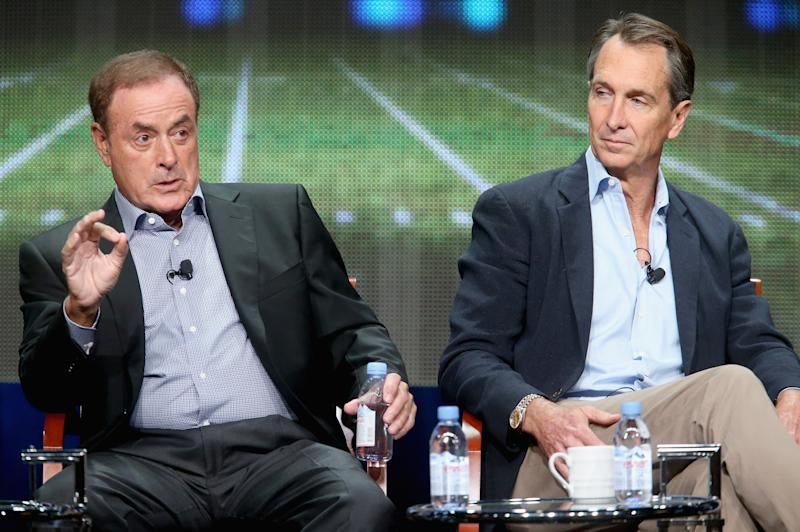 Announcer Al Michaels and analyst Cris Collinsworth didn't seem happy about wearing masks to call the Sunday night game. (Photo by Frederick M. Brown/Getty Images)