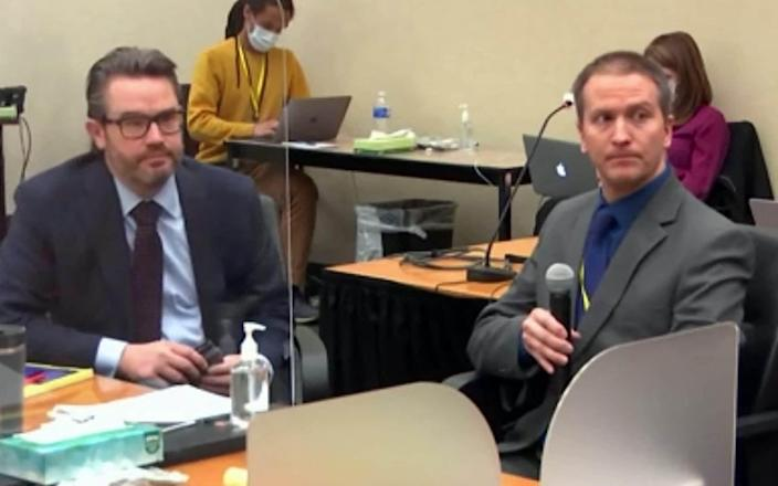 Derek Chauvin (right) next to his Defence attorney Eric Nelson during the trial - ALEX LEDERMAN/Court TV/AFP via Getty Images