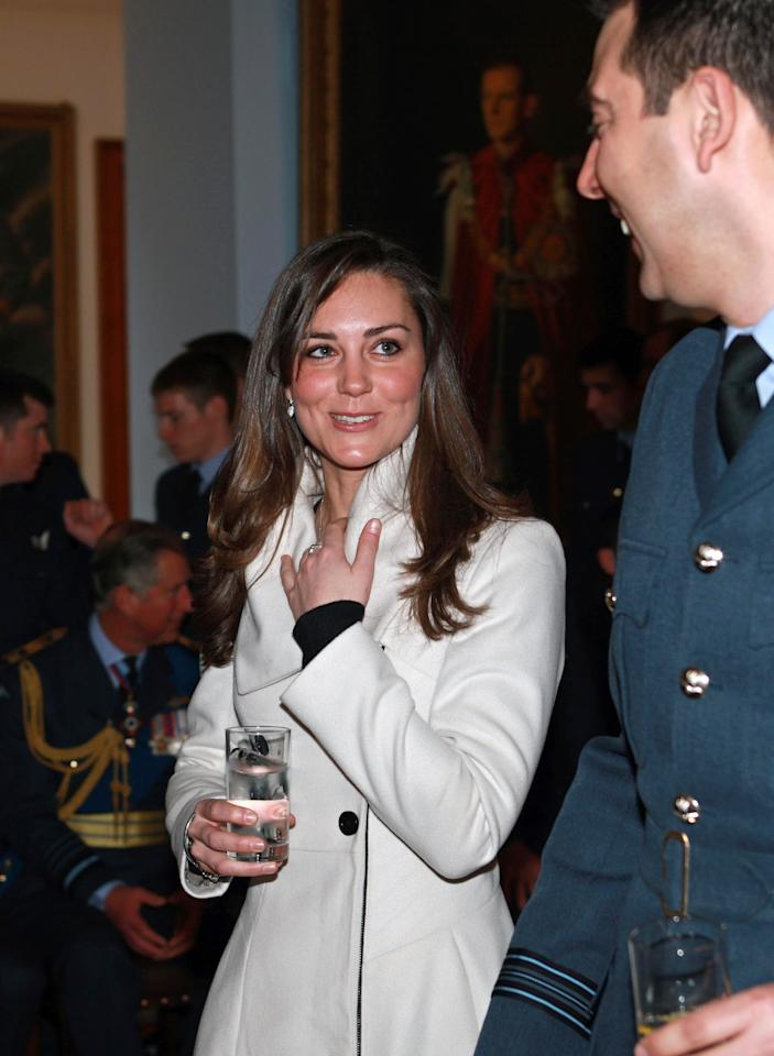 Kate Middleton,  girlfriend of Britain's Prince William, is pictured after his graduation ceremony at RAF Cranwell air base in Lincolnshire, on April 11, 2008. Britain's Prince William graduated as a Royal Air Force (RAF) pilot on Friday after successfully completing an intensive flying course.The prince, 25, received his wings from his father Prince Charles in a graduation ceremony at the RAF Cranwell air base in Lincolnshire, east central England. AFP PHOTO/MICHAEL DUNLEA/POOL (Photo credit should read MICHAEL DUNLEA/AFP via Getty Images)