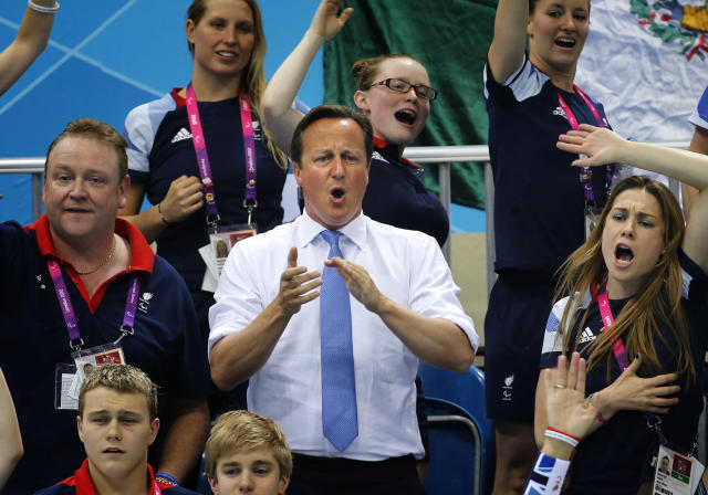 British Prime Minister David Cameron cheers for Eleanor Simmonds during her race in the Women's 200m IM SM6 Final at the 2012 Paralympics Olympics, Monday, Sept. 3, 2012, in London. (AP Photo / Emilio Morenatti)