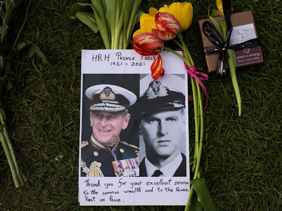 Members of the public leave floral tributes to Prince Philip outside of Windsor Castle (Getty Images)