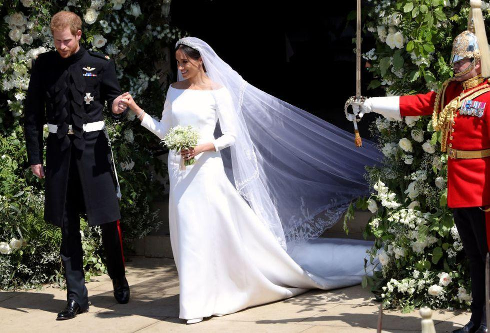 <p>Much to the surprise of everyone, Meghan chose British designer Clare Waight Keller of Givenchy to design her sleek and modern wedding gown. While both dresses featured long sleeves, Meghan's gown was unadorned by beading or lace and had a boat neckline instead of Kate's now-iconic v-neck dress.</p>