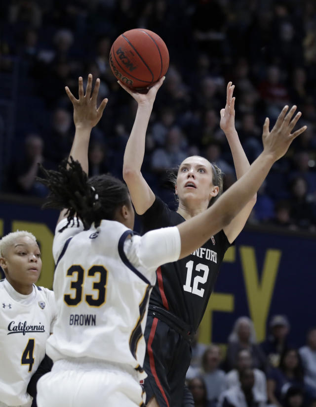 Stanford's Lexie Hull, right, shoots against California's Jaelyn Brown (33) in the first half of an NCAA college basketball game Sunday, Jan. 12, 2020, in Berkeley, Calif. (AP Photo/Ben Margot)