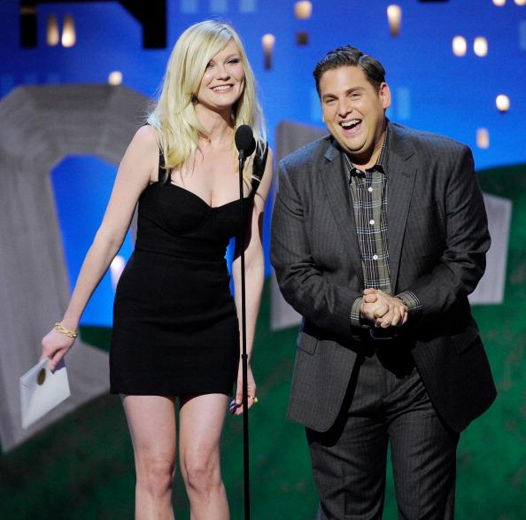Actors Kirsten Dunst (L) and Jonah Hill speak onstage at the 2012 Film Independent Spirit Awards held at the Santa Monica Pier on February 25, 2012 in Santa Monica, California. (Photo by Kevork Djansezian/Getty Images)
