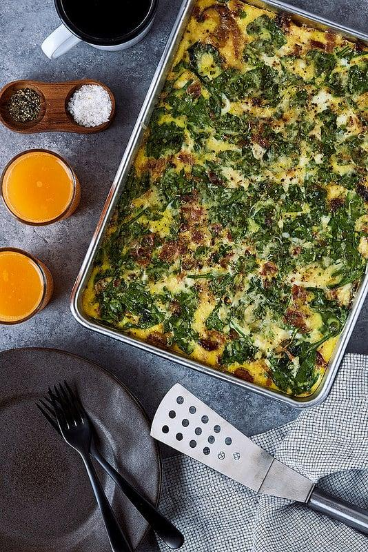 """<p><a rel=""""nofollow"""" href=""""https://www.popsugar.com/food/How-Chefs-Make-Scrambled-Eggs-40688524"""">Eggs from the stovetop</a> are delicious, but you'll make larger servings faster in the oven. This version of baked eggs includes bacon, spinach, and goat cheese (yum), but you can add any ingredients you like.</p> <p><strong>Get the recipe:</strong> <a rel=""""nofollow"""" href=""""http://tasty-yummies.com/how-to-make-sheet-pan-baked-eggs/"""">baked eggs</a></p>"""