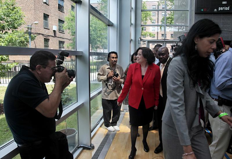 FILE - In this June 4, 2010, file photo, U.S. Supreme Court Justice Sonia Sotomayor, center, leaves after a naming ceremony in her honor at the Bronxdale Houses in the Bronx borough of New York, Friday, June 4, 2010. The Bronxdale Houses, a city housing development where Sotomayor lived as a child, was renamed Justice Sonia Sotomayor House following a petition drive by residents to honor her. (AP Photo/Bebeto Matthews, File)