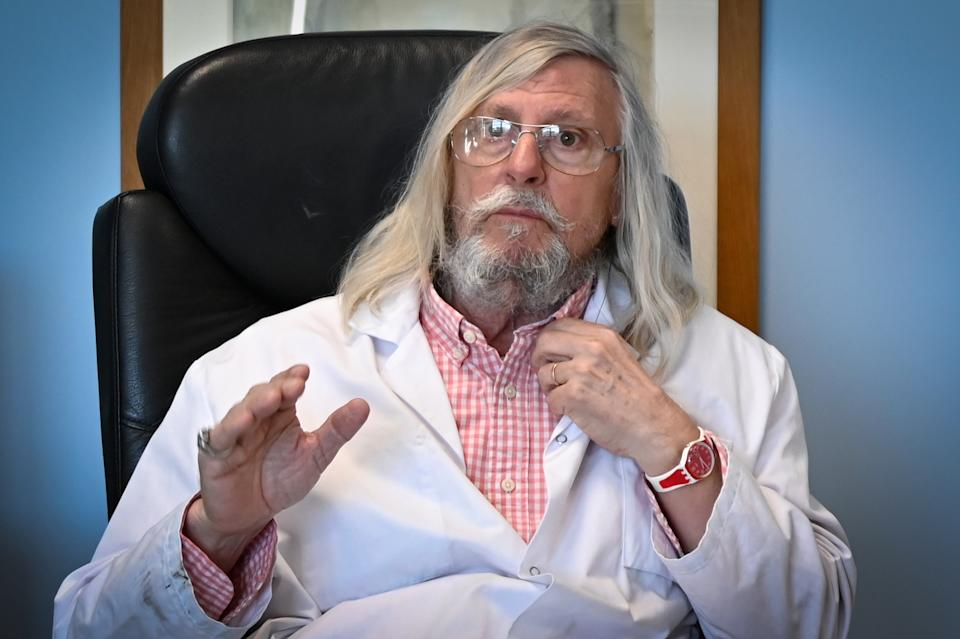 """French professor Didier Raoult, biologist and professor of microbiology, specialized in infectious diseases and director of IHU Mediterranee Infection Institute speaks on February 26, 2020 in his office in Marseille, southeastern France. - The controversial French professor of microbiologist Didier Raoult, who believes the anti-malaria drug chloroquine can help beat the coronavirus, has claimed that a new study he has conducted confirms its """"efficiency"""" at combatting the virus. But several other scientists and critics of Raoult, who heads the infectious diseases department of La Timone hospital in Marseille, were quick to cast doubt upon his findings on March 29, 2020. (Photo by GERARD JULIEN / AFP) (Photo by GERARD JULIEN/AFP via Getty Images)"""