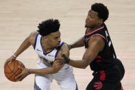 Golden State Warriors guard Quinn Cook, left, is defended by Toronto Raptors guard Kyle Lowry during the first half of Game 3 of basketball's NBA Finals in Oakland, Calif., Wednesday, June 5, 2019. (AP Photo/Tony Avelar)