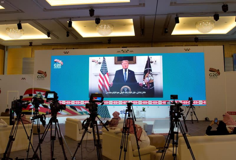 U.S. President Donald Trump's virtual speech is aired live in media centre of the 15th annual G20 Leaders' Summit, in Riyadh, Saudi Arabia