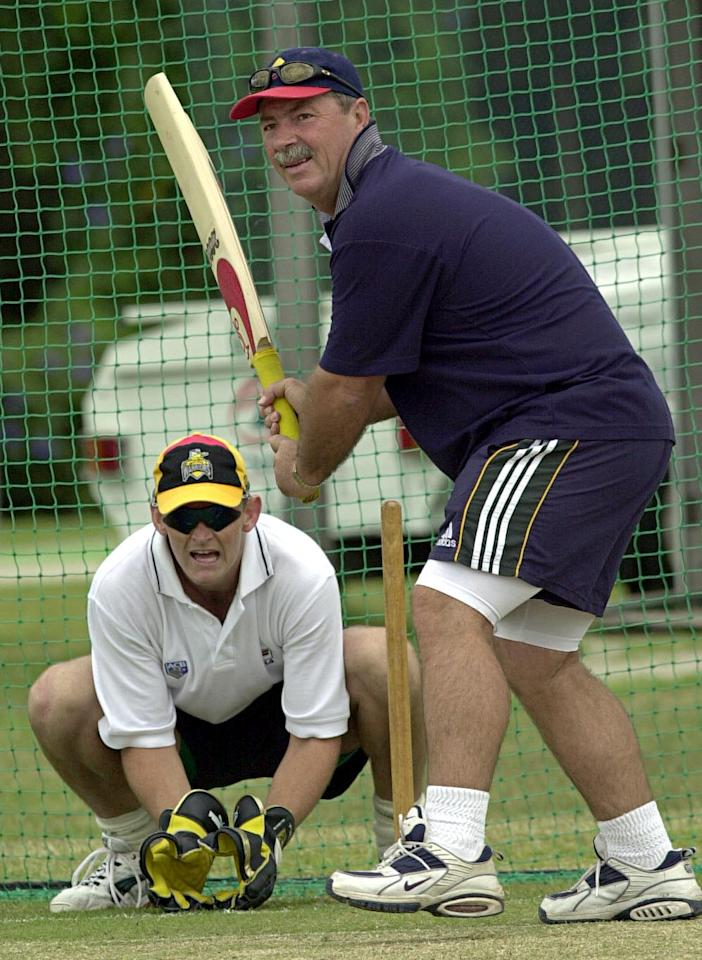 02 Nov 2000:  Adam Gilchrist of the Australian Cricket team shows his wicket keeping skills to former Australian wicket keeper, Rod Marsh during a training session at Buderim on the Sunshine Coast, Australia. The Australian Cricket team are having a fiveday training camp at Mooloolaba to prepare for the test series against the West Indies. DIGITAL IMAGE. Mandatory Credit: Darren England/ALLSPORT
