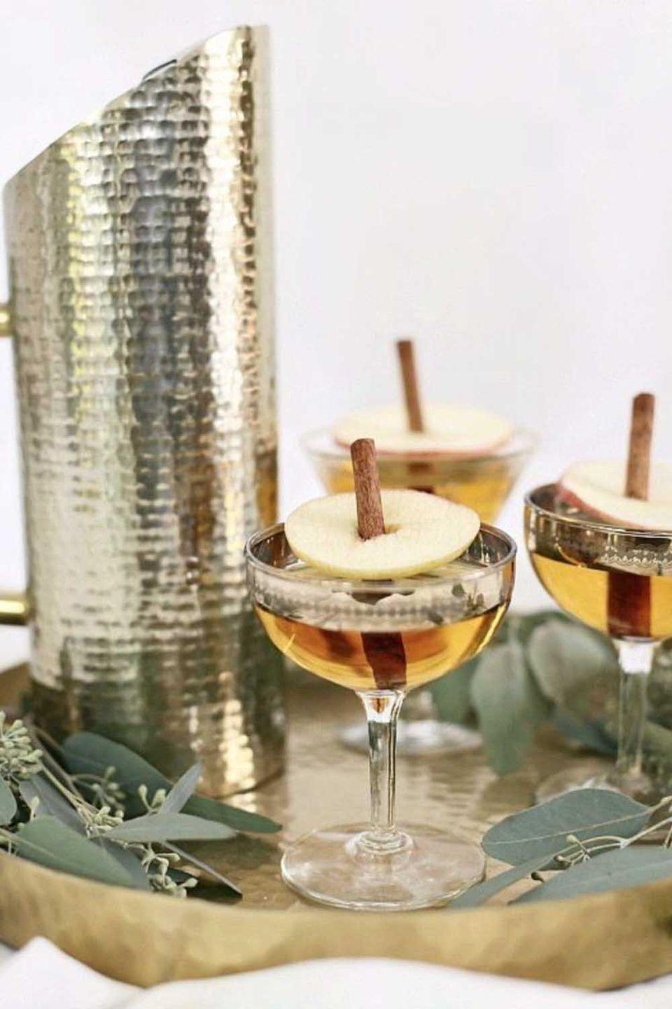 """<p>This drink uses apple juice instead of cider to keep it clear and amber, so serve it in your prettiest glasses to show off its autumn hue.</p><p><a class=""""link rapid-noclick-resp"""" href=""""https://celebrationsathomeblog.com/apple-pie-cocktail/"""" rel=""""nofollow noopener"""" target=""""_blank"""" data-ylk=""""slk:GET THE RECIPE"""">GET THE RECIPE</a></p>"""