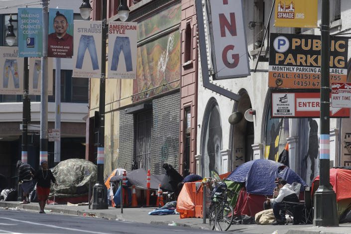 "FILE - In this April 18, 2020, file photo, tents line a sidewalk on Golden Gate Avenue in San Francisco. A coalition in California is proposing legislation to boost taxes on wealthy multi-national corporations to raise more than $2 billion a year to end homelessness. Supporters say Assembly Bill 71, if approved, would ""reinvent"" the state's approach to solving homelessness. (AP Photo/Jeff Chiu, File)"