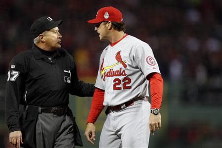 Oct 23, 2013; Boston, MA, USA; St. Louis Cardinals manager Mike Matheny (22) reacts after a call is overturned by umpire John Hirschbeck (17) during the first inning in game one of the MLB baseball World Series at Fenway Park. Greg M. Cooper-USA TODAY Sports