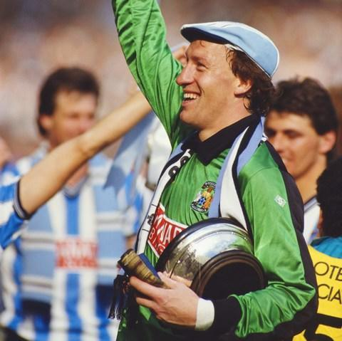 "Even now, nearly 31 years on from that scorching Wembley afternoon, Steve Ogrizovic cannot escape Coventry City's famous day in the sun. ""Wherever I go, there will be somebody mentioning the 1987 FA Cup final against Spurs,"" he says, smiling. ""People will say it was the best day of their lives. I always ask them 'what about the day you got married, or the day when your kids were born' but they just want to talk about the final. The fans who went to Wembley have dined out on it ever since. Not a day goes by without it being mentioned. ""If you talk to the staff here, they'll also say I mention it every day – but I can assure you it's not true…"" With Ogrizovic in goal, Coventry secured one of the most memorable victories in the cup's long history when they defeated Tottenham Hotspur 3-2. Spurs - runaway favourites, despite only finishing eight points ahead of Coventry in the First Division that season - led twice but City, playing in their first major final, were in no mood to lie down. Coventry striker Keith Houchen dives to head past Spurs goalkeeper Ray Clemence - as Chris Hughton, now Brighton manager, watches on Credit: Hulton Archive After Keith Houchen's spectacular airborne header took the game into extra time, the defining moment came in the 95th minute, when the unfortunate Gary Mabbutt diverted Lloyd McGrath's cross over his own goalkeeper Ray Clemence for the winner. The moment was immortalised by the creation of Coventry's famous fanzine 'Gary Mabbutt's Knee', while the BBC's John Motson described the game as ""the finest final I've had the pleasure of commentating on"". For Ogrizovic, now Coventry's goalkeeping coach, the memories remain vivid. ""It was the game which really put Coventry on the map, in terms of being the first major trophy the club had ever won,"" he recalls. ""The great thing about that game is not only Coventry winning but how it's remembered as an entertaining, exciting final. ""The finals weren't always that entertaining in those days, which people forget. There certainly weren't too many with five goals. It really doesn't feel so long ago."" Yet Ogrizovic's warm memories of that May day are also tinged with sadness. Leading the line for City for the whole 120 minutes at Wembley was Cyrille Regis, whose tragic death at the age of 59 last month left the English game - and the west midlands, in particular - in mourning. ""Football is the all poorer without Cyrille in it,"" Ogrizovic says. ""Everybody in the football world was absolutely devastated, not just in Coventry, West Brom or Wolverhampton, but throughout the country. ""He was such a brilliant guy, not just a fantastic footballer and team-mate but a fantastic friend. You've seen that with the eulogies and testimonials that people have recounted since. He was such a loss."" Steve Ogrizovic at Cyrille Regis's memorial service at the Hawthorns Credit: West Bromwich Albion FC Regis's passing should ensure even more support from the neutrals tomorrow, when Coventry attempt to revive their FA Cup pedigree with a visit to Premier League Brighton. In an ironic twist, the man in charge of Brighton - Chris Hughton - played in the Spurs defence in that Wembley classic. Coventry will be backed by nearly 5,000 fans at the Amex Stadium, and there is a sense of the feel-good factor returning to a fanbase that has spent much of the last decade fighting the ownership of hedge fund Sisu - a period which has seen them temporarily abandon their Ricoh Arena home, plunge into the bottom tier of English football and work their way through nine managers. Throughout this period, Ogrizovic, now 60, has been a reassuringly constant presence. He made 601 appearances for the club after joining in 1984, and has held a variety of roles - including caretaker manager - since his retirement in 2000. For many fans, he represents hope that better times will be around the corner. Steve Ogrizovic celebrates the Cup triumph in 1987 Credit: David Cannon Collection ""I've been very fortunate. My first contract was for three years and never in my wildest dreams did I envisage being here for so long,"" he says. ""I've been academy manager, under-18s coach, caretaker manager and now goalkeeping coach. The best part of football is playing, the second best is coaching and being a part of the set-up. ""Although we're all getting older, football keeps you young. I just love coming in every day. It's been quite a journey but such an enjoyable one."" A second Premier League scalp of the season - City defeated Stoke in round three, leading to the sacking of Mark Hughes - would be another memorable instalment of Ogrizovic's Coventry story, and he is not discounting an upset. Cup kings 