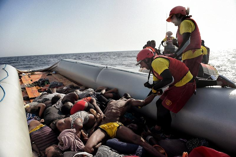 Members of Spanish humanitarian NGO Proactiva Open Arms, drag corpses of refugees and migrants after a rescue operation off the coast of Libya on October 4, 2016