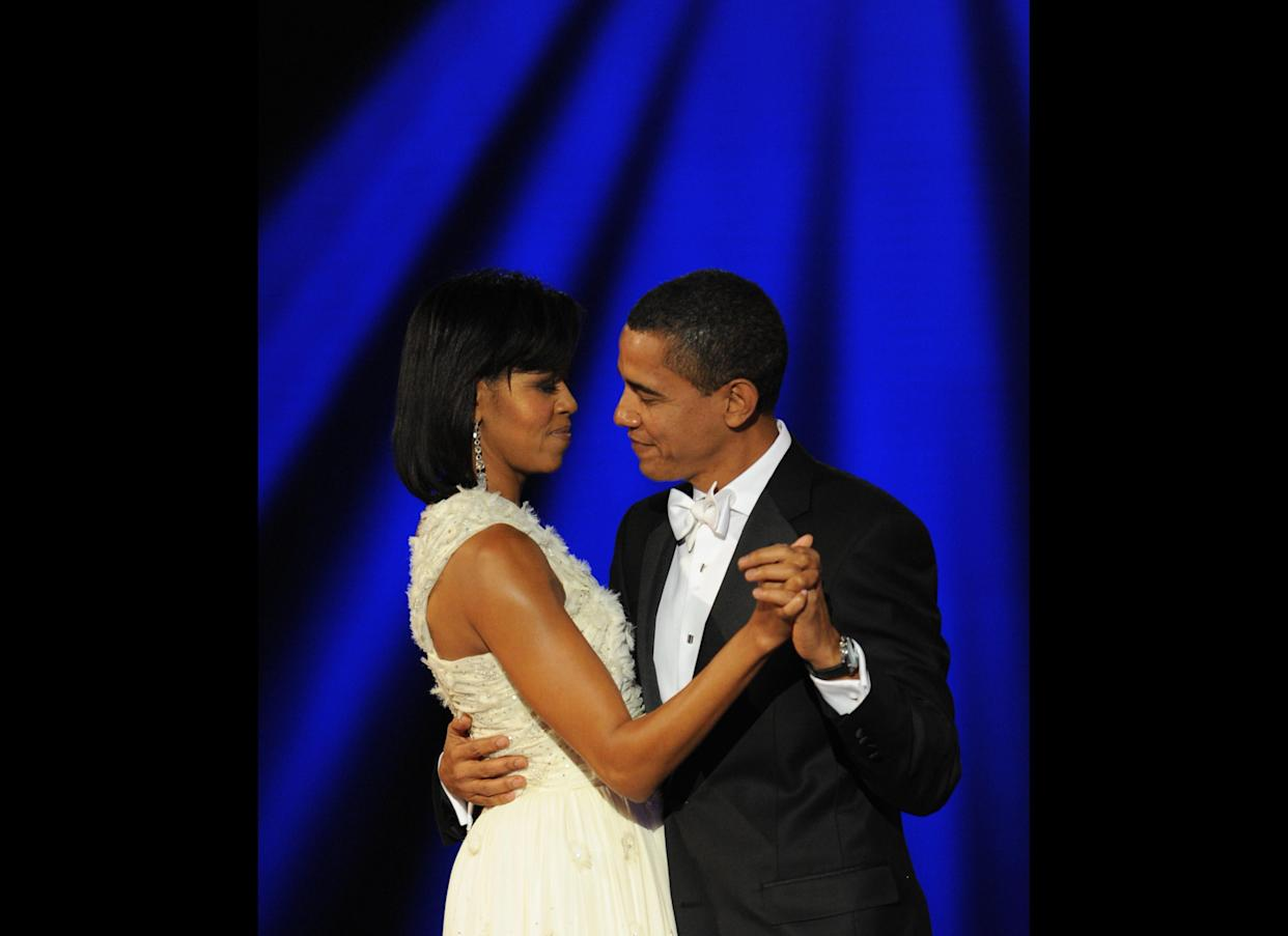 US President Barack Obama and his wife Michelle dance at the Neighborhood Ball January 20, 2009 in Washington, D.C., the first of ten inauguration balls. AFP PHOTO/Stan HONDA (Photo credit should read STAN HONDA/AFP/Getty Images)