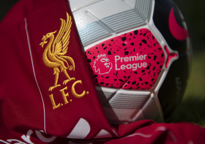 MANCHESTER, ENGLAND - MAY 04: The Liverpool club crest on the first team home shirt with the official Nike Premier League Match Ball on May 4, 2020 in Manchester, England (Photo by Visionhaus)