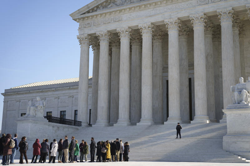 Members of the public wait in line outside the U.S. Supreme Court for a chance to hear oral arguments inside the court on March 2, 2020 in Washington, DC.