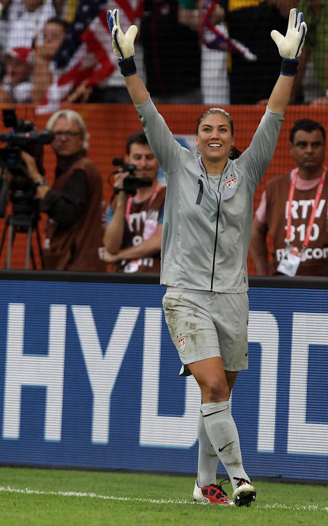 DRESDEN, GERMANY - JULY 10: Hope Solo, goalkeeper of USA celebrates after she saves a penalty during penalty shoot out during the FIFA Women's World Cup 2011 Quarter Final match between Brazil and USA at Rudolf-Harbig-Stadion on July 10, 2011 in Dresden, Germany. (Photo by Martin Rose/Getty Images)