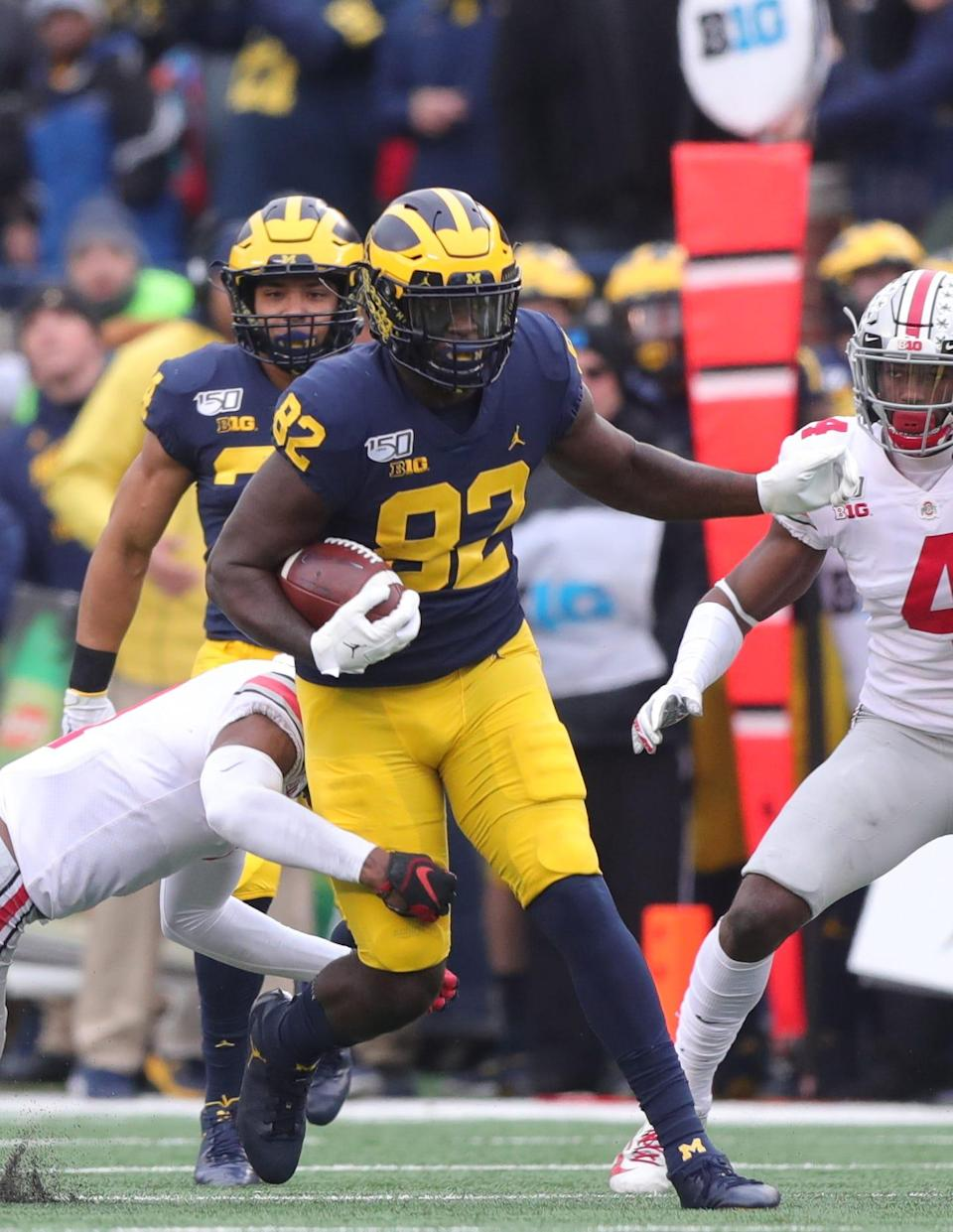 Michigan Wolverines right end Nick Eubanks is tackled by Ohio State Buckeyes cornerback Jeff Okudah during the first half Saturday, Nov. 30, 2019 at Michigan Stadium.
