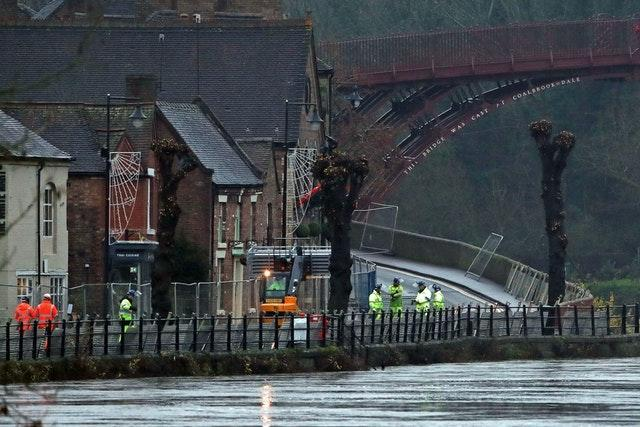 Flood bariries being erected on the River Severn, near Ironbridge, Shropshire (Nick Potts/PA)
