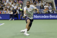 Marin Cilic, of Croatia, returns a shot against Rafael Nadal, of Spain, during the fourth round of the U.S. Open tennis tournament Monday, Sept. 2, 2019, in New York. (AP Photo/Seth Wenig)