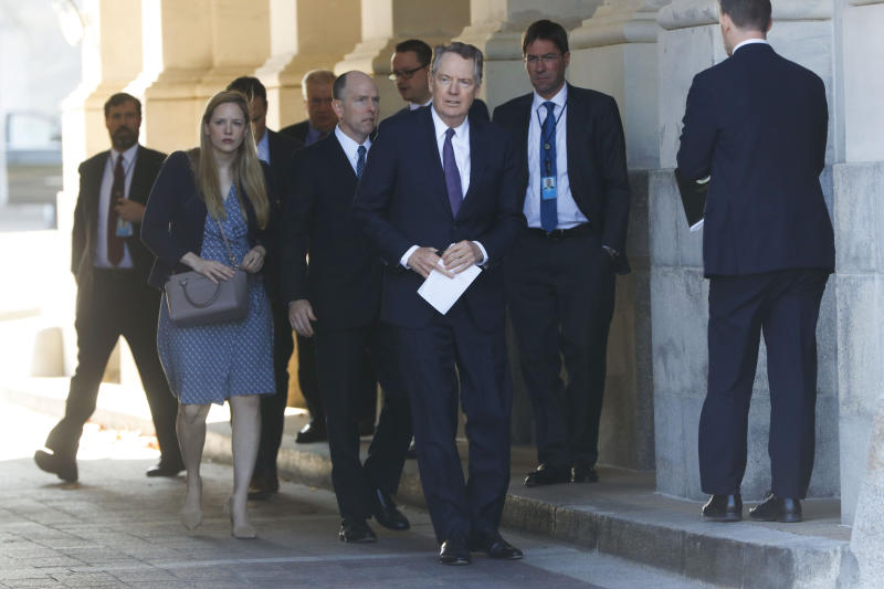 U.S. Trade Representative Robert Lighthizer, center, and members of his staff leave the U.S. Capitol, Thursday, Jan. 16, 2020. Earlier the Senate overwhelmingly approved a new North American trade agreement that rewrites the rules of trade with Canada and Mexico and gives President Donald Trump a major policy win before senators turn their full attention ti his impeachment trial. (AP Photo/Pablo Martinez Monsivais)