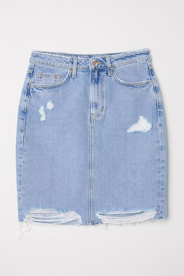 """<p>Everyone needs a denim skirt for spring, and while we might need to wait under it heats up a bit before going bare-legged, this H&M number is going swiftly in the shopping basket. <em><a rel=""""nofollow"""" href=""""http://www2.hm.com/en_gb/productpage.0554640003.html"""">Buy here.</a></em><br /><br /></p>"""