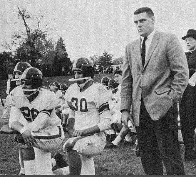 Joe Biden (30) crouches beside Archmere coach John Walsh (second from right) in 1960.