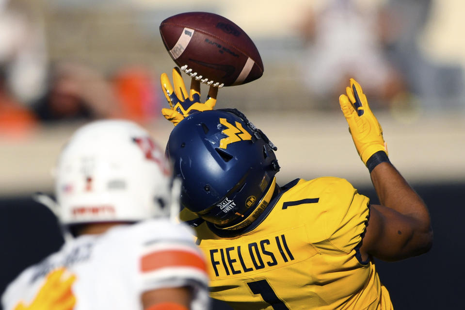 West Virginia linebacker Tony Fields II intercepts a pass against Oklahoma State. (AP Photo/Brody Schmidt)