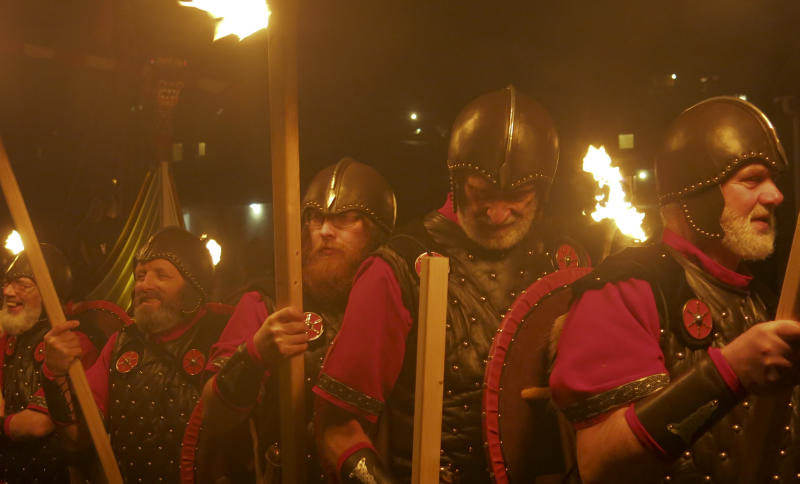 <p> In this photo taken March 14, 2014, locals dressed as Vikings carry torches as they take part in the annual Up Helly Aa, Viking fire festival in Gulberwick, Shetland Islands north of mainland Scotland. The fearsome-looking participants in the festival live in Scotland's remote Shetland Islands, a wind-whipped northern archipelago where many claim descent from Scandinavian raiders. They are cool to the idea of Scotland leaving Britain to form an independent nation, and determined that their rugged islands will retain their autonomy whatever the outcome of September's referendum. (AP Photo/Jill Lawless) </p>