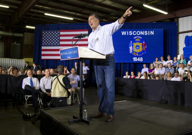 Republican presidential candidate, former Massachusetts Gov. Mitt Romney gestures during a campaign stop at Monterey Mills on Monday, June 18, 2012 in Janesville, Wis.  (AP Photo/Evan Vucci)