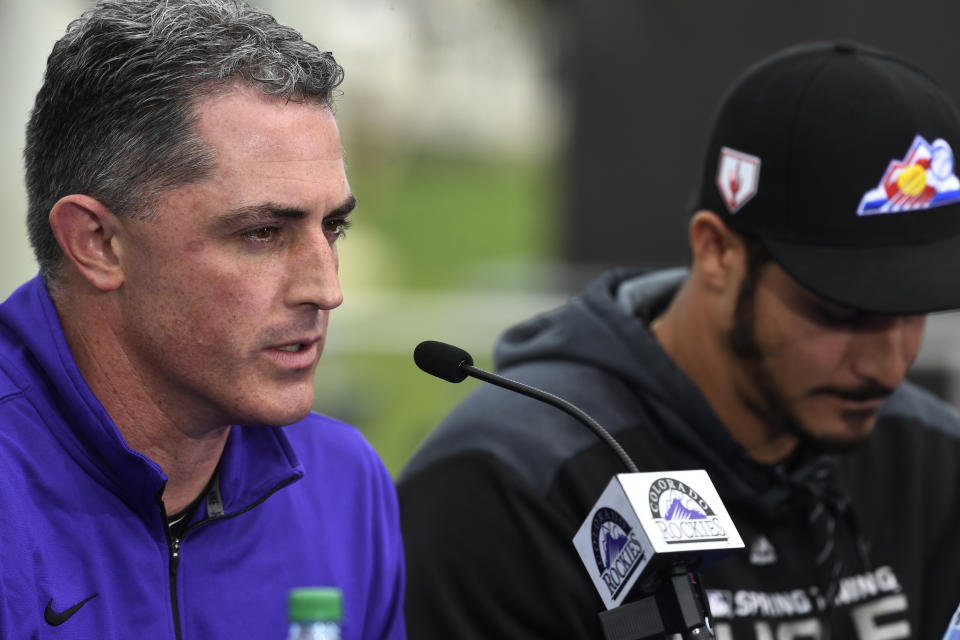 SCOTTSDALE, AZ - FEBRUARY 27: Colorado Rockies general manager Jeff Bridich, left, speaks during Colorado Rockies third baseman Nolan Arenado's press conference at Salt River Fields February 27, 2019. Colorado Rockies owner, Dick Montfort, right, sits next to Nolan. The Colorado Rockies and Arenado signed a 8-year, $260 million dollar deal, largest in franchise history,  with a opt-out clause after three years. (Photo by Andy Cross/MediaNews Group/The Denver Post via Getty Images)