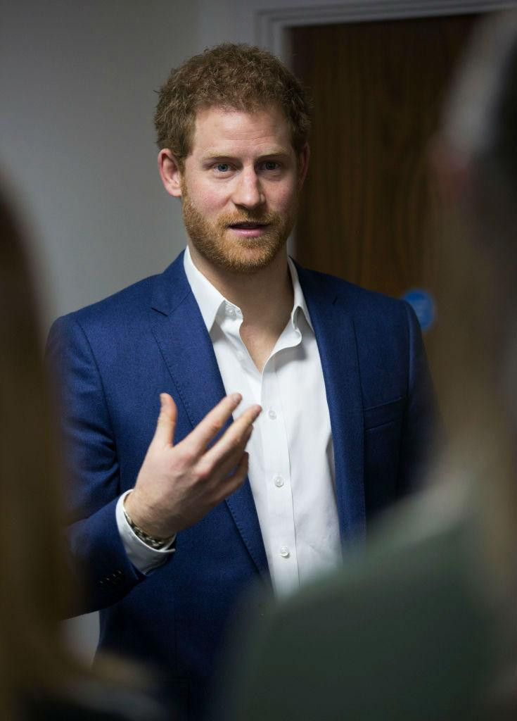 Prince Harry Visits Big White Wall In Navy Suit