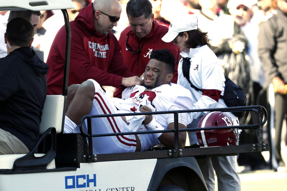 Alabama quarterback Tua Tagovailoa (13) is carted off the field after getting injured in the first half against Mississippi State. (AP)