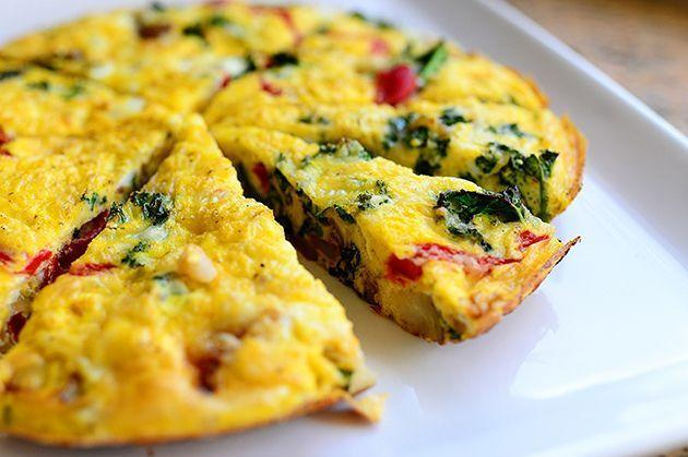 """<p>This frittata is simple and delicious. Ree uses onions, cheese, kale, roasted red peppers, olives, and potatoes (yum!), but you can easily customize it based on Mom's favorite ingredients.</p><p><a href=""""https://www.thepioneerwoman.com/food-cooking/recipes/a11356/sunday-frittata/"""" rel=""""nofollow noopener"""" target=""""_blank"""" data-ylk=""""slk:Get the recipe."""" class=""""link rapid-noclick-resp""""><strong>Get the recipe.</strong></a></p><p><a class=""""link rapid-noclick-resp"""" href=""""https://go.redirectingat.com?id=74968X1596630&url=https%3A%2F%2Fwww.walmart.com%2Fsearch%2F%3Fquery%3Dskillets%26cat_id%3D4044&sref=https%3A%2F%2Fwww.thepioneerwoman.com%2Ffood-cooking%2Frecipes%2Fg36145857%2Fbreakfast-in-bed-recipes%2F"""" rel=""""nofollow noopener"""" target=""""_blank"""" data-ylk=""""slk:SHOP SKILLETS"""">SHOP SKILLETS</a></p>"""