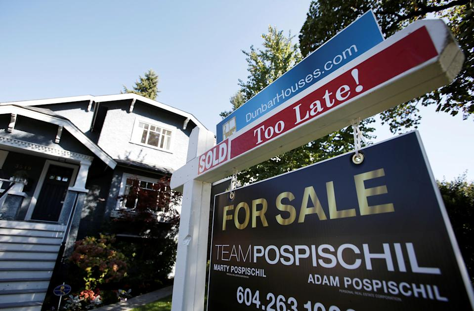 A for sale sign is pictured in front of a home in Vancouver, B.C., Sept. 22, 2016. (Canadian Press)