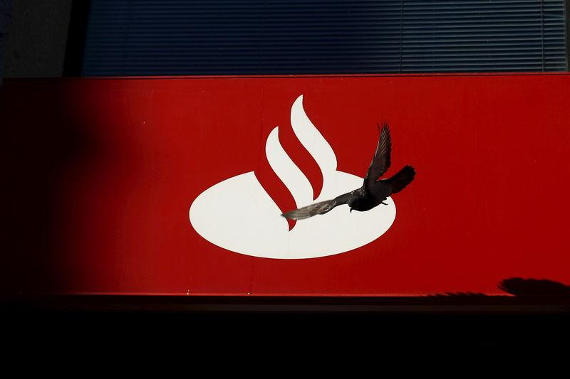 FILE PHOTO: A pigeon flies past a logo of Spain's biggest bank Santander in downtown Malaga, southern Spain, in this file picture taken April 1, 2016. REUTERS/Jon Nazca/Files