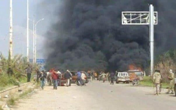 Still image shows a cloud of black smoke rising from vehicles after a bombing on a convoy outside Aleppo - REUTERS