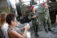 Soldiers sing and dance with residents at a military event organised to 'return happiness to the people' at Victory Monument, the site of recent anti-coup rallies in Bangkok, on June 4, 2014