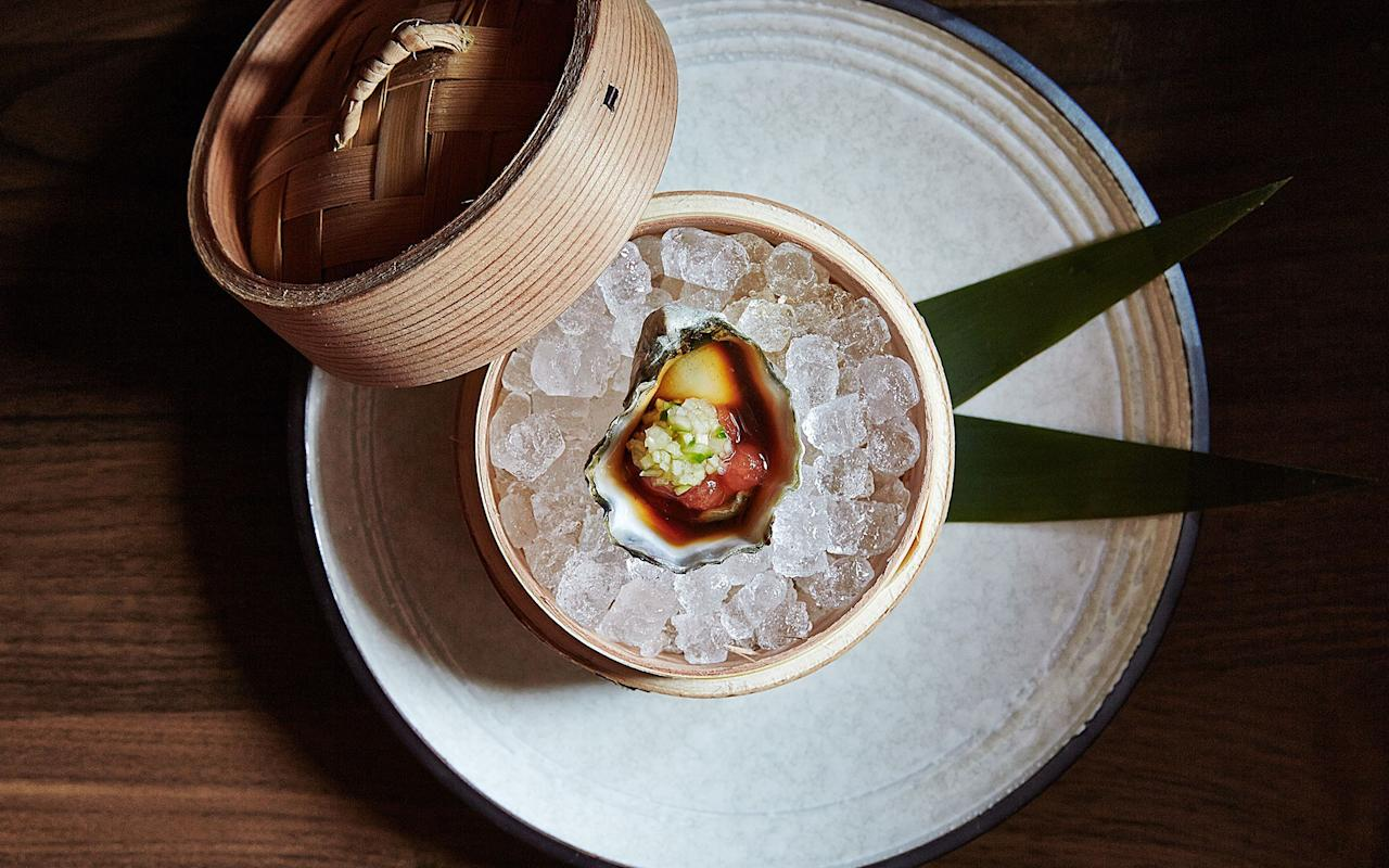 Given the larger-than-life reputation of this cult-classic sushi and omakase restaurant, you would expect it to have a more grandiose address than a 30-seat dining room off an anonymous side street in the Leather District. But that's the magic of O Ya—the food is enough to make it a must-try for any serious sushi enthusiast passing through Boston. Rolls, sashimi, and the like can be ordered à la carte, but any Bostonian worth their weight in salty soy sauce knows that it's omakase menu or bust here. Some dishes are deeply traditional, while others throw unexpected yet decadent flavors into the mix, like foie gras and truffle.
