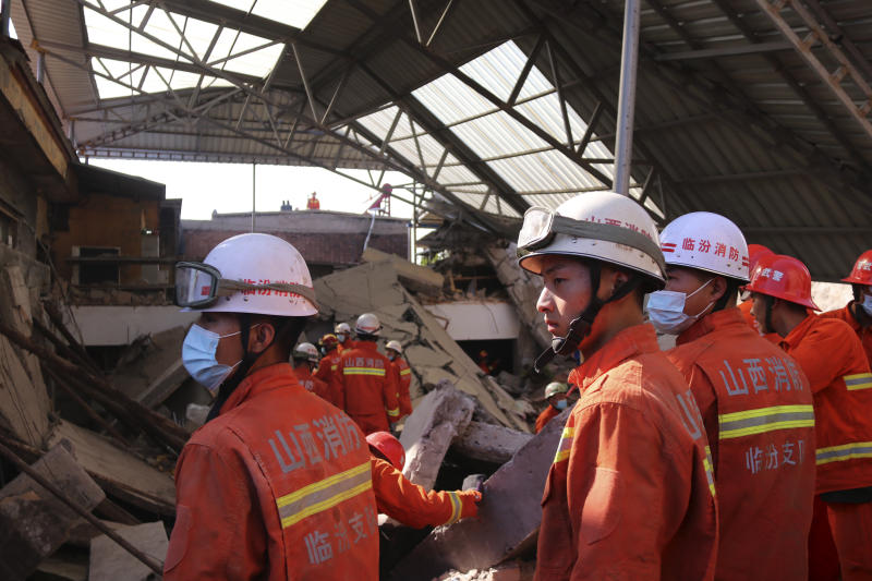 Rescuers search for victims in the aftermath of the collapse of a two-story restaurant in Xiangfen county in northern China's Shanxi province onAugust 29. Source: Chinatopix via AP