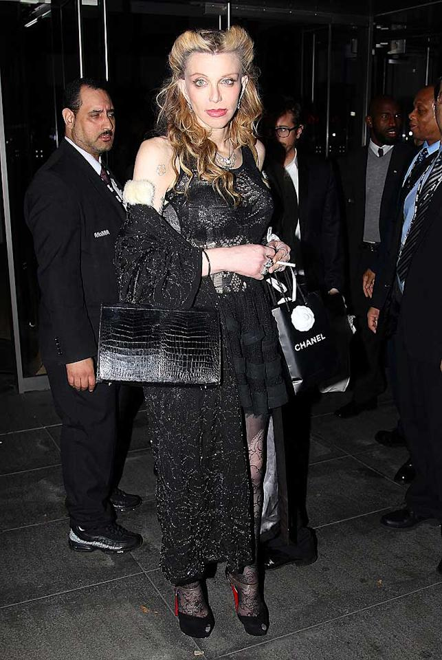 9. Rocker Courtney Love -- in a gothic getup, tacky accessories, and a bizarre coif -- at a glamorous fundraising benefit in NYC. (11/15/2011)