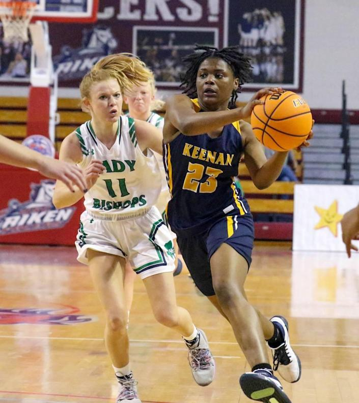 Bishop England's Alli Dominiak chases Keenan's MiLaysia Fulwiley (23) downcourt during the 3A state championship game at the USC Aiken Convocation Center on Friday, March 5, 2021.