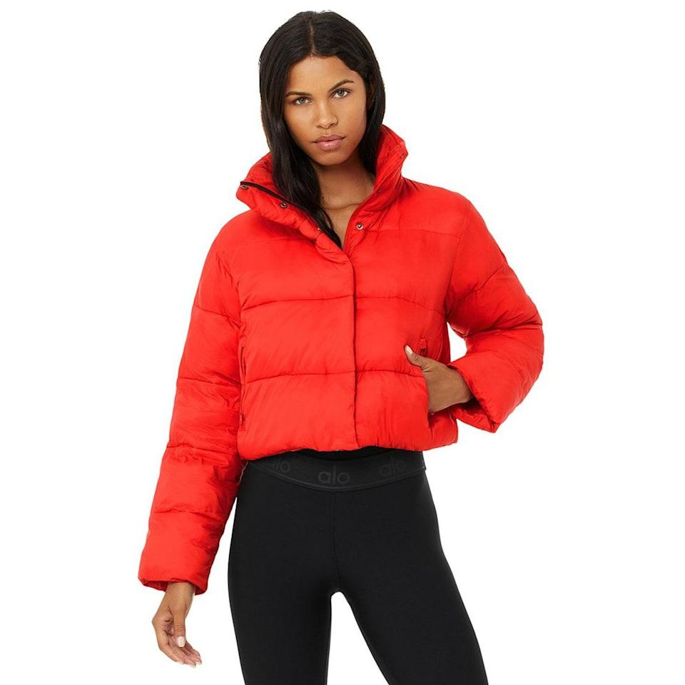 """Can you even winter without a reliable puffer jacket? A bright red one is the perfect way to liven up your winter wardrobe—and you can wear it with virtually anything in your closet. $198, Alo. <a href=""""https://www.aloyoga.com/products/w4380r-gold-rush-puffer-cherry"""" rel=""""nofollow noopener"""" target=""""_blank"""" data-ylk=""""slk:Get it now!"""" class=""""link rapid-noclick-resp"""">Get it now!</a>"""